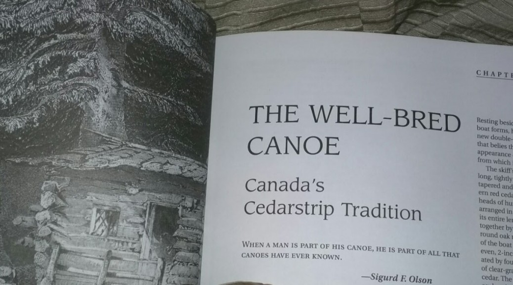 Reading a page from Canoecraft, by Ted Moores